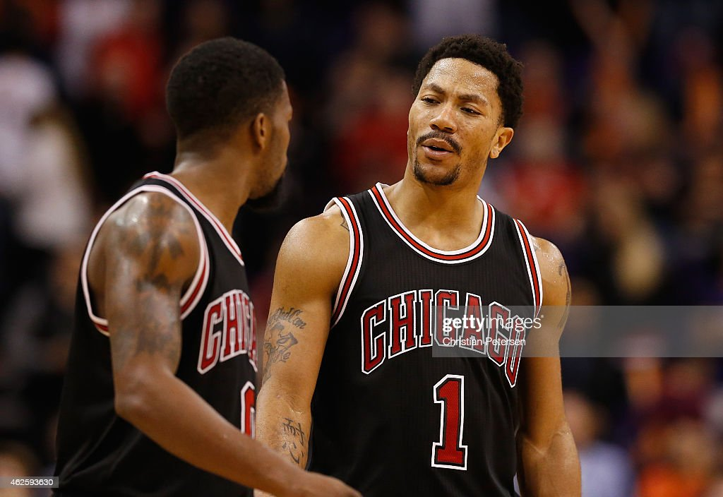 1be52cdb2a49 Derrick Rose and Aaron Brooks of the Chicago Bulls during the second ...