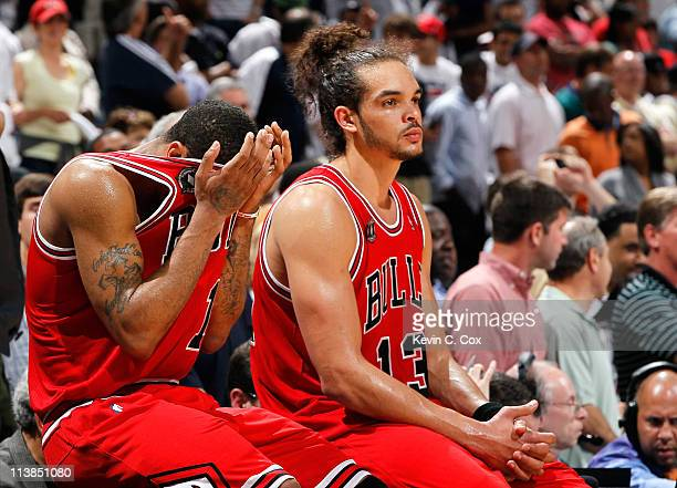 Derrick Rose and Joakim Noah of the Chicago Bulls react as they wait to come back in after a timeout against the Atlanta Hawks in the final minutes...