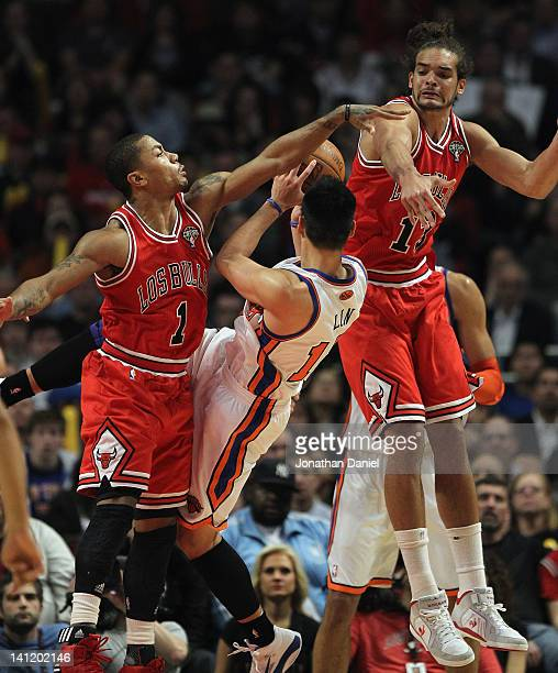 Derrick Rose and Joakim Noah of the Chicago Bulls stop a shot by Jeremy Lin of the New York Knicks at the United Center on March 12 2012 in Chicago...
