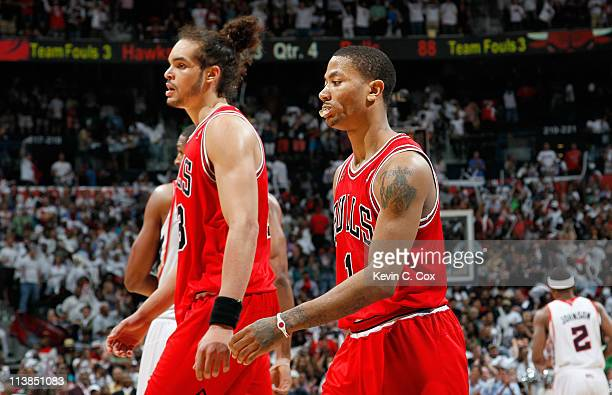 Derrick Rose and Joakim Noah of the Chicago Bulls walk off the court after a timeout against the Atlanta Hawks in Game Four of the Eastern Conference...