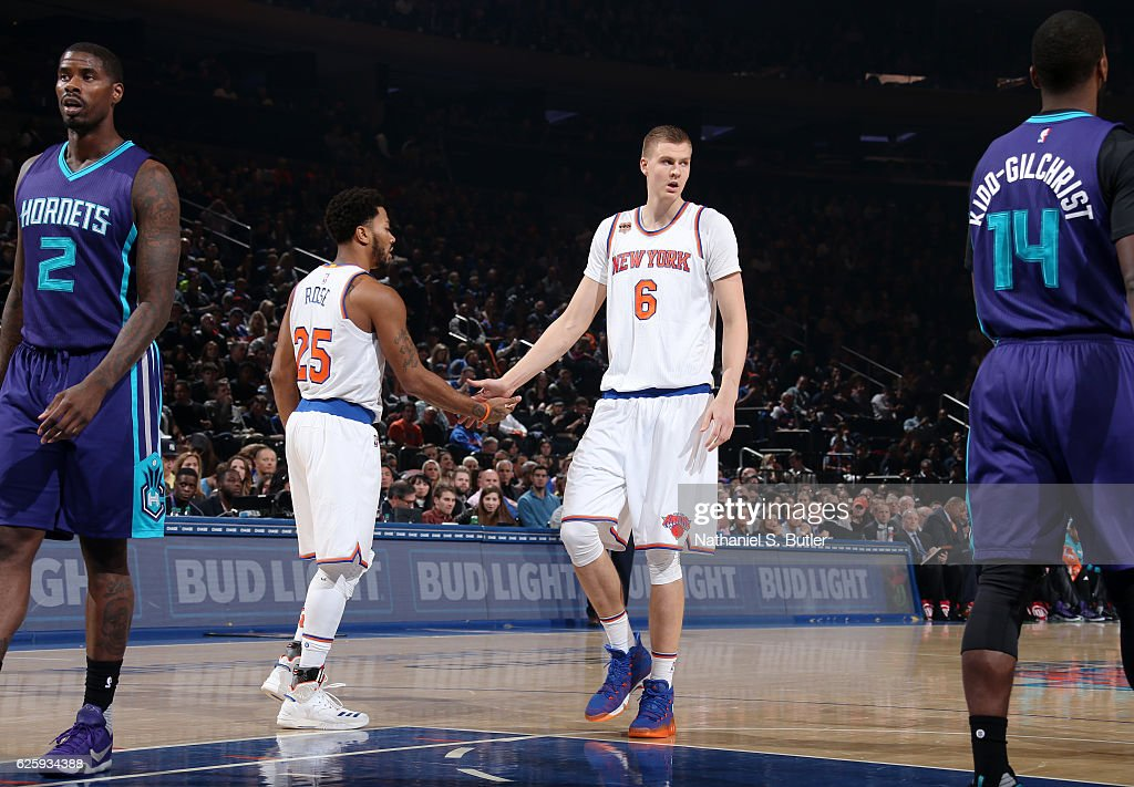 Derrick Rose #25 and Kristaps Porzingis #6 of the New York Knicks high five during the game against the Charlotte Hornets at Madison Square Garden in New York, New York.