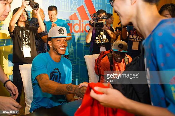 Derrick Rose Chicago Bulls point guard gives signatures to fans on August 21 2015 in Guangzhou Guangdong Province of China