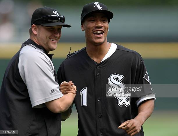 Derrick Rose number 1 overall pick in the 2008 NBA Draft by the Chicago Bulls shares a laugh with Mark Buehrle of the Chicago White Soxafter he threw...
