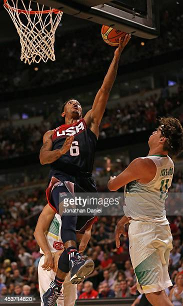 Derrick Rose of team USA drives to the basket over Anderson Varejao of team Brazil during an exhibition game at the United Center on August 16 2014...