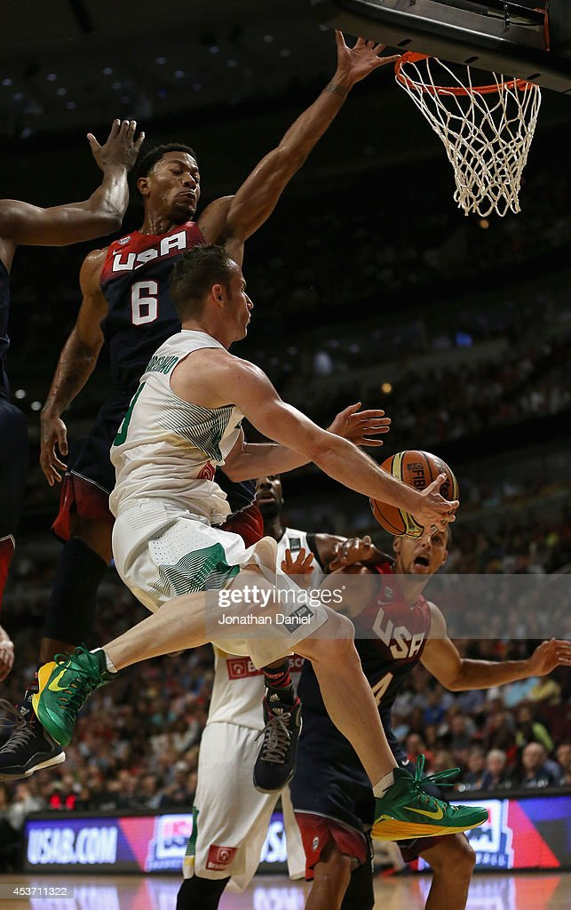 Derrick Rose #6 of team USA leaps to defend against Marcelo Huertas #9 of team Brazil during an exhibition game at the United Center on August 16, 2014 in Chicago, Illinois.