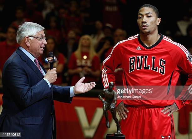 Derrick Rose of the Chicago Bulls accepts the Maurice Podoloff Trophy awarded to the NBA Most Valuable Player from Commissoner David Stern before...