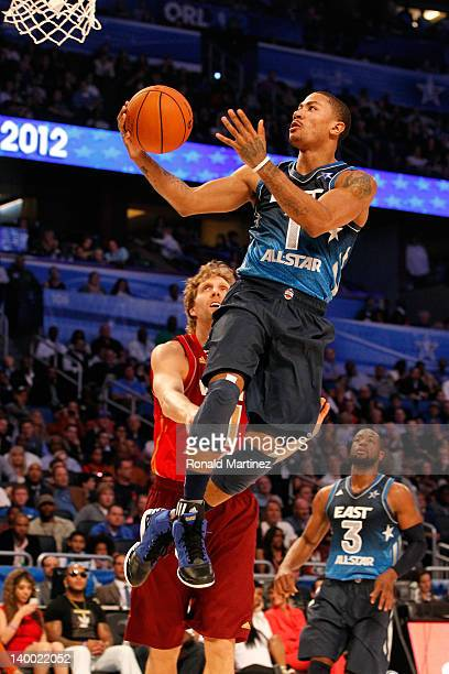 Derrick Rose of the Chicago Bulls and the Eastern Conference drives for a shot attempt against Dirk Nowitzki of the Dallas Mavericks and the Western...