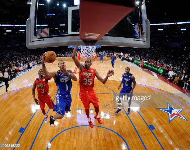 Derrick Rose of the Chicago Bulls and the Eastern Conference goes up for a shot against Kevin Durant of the Oklahoma City Thunder and the Western...
