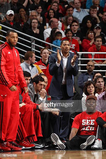 38741570d85a Derrick Rose of the Chicago Bulls applauds his team from the bench in Game  Six of