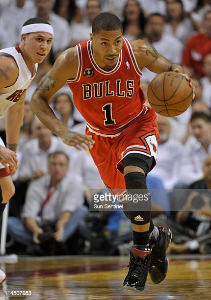 Derrick Rose of the Chicago Bulls brings the ball up the court as Mike Bibby of the Miami Heat looks on in the first quarter during Game 3 of the NBA...