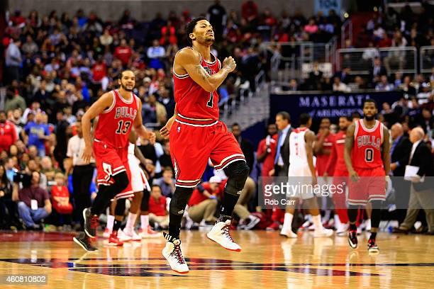Derrick Rose of the Chicago Bulls celebrates after making a shot in the second half of the Bulls 9991 win over the Washington Wizards at Verizon...