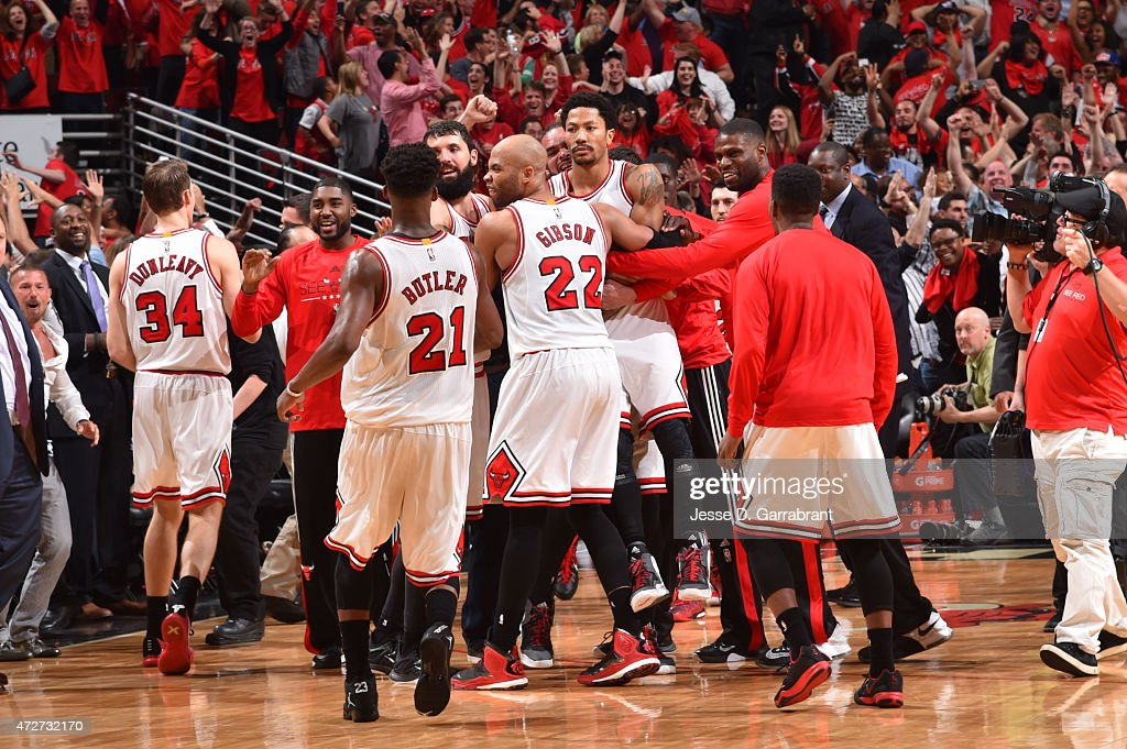Derrick Rose #1 of the Chicago Bulls celebrates with teammates after hitting the game winning three pointer with three seconds left in the game against the Cleveland Cavaliers at the United Center During Game Two of the Eastern Conference Semifinals during the 2015 NBA Playoffs on May 8, 2015 in Chicago,Illinois