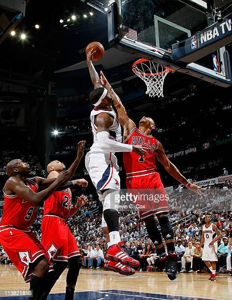 Derrick Rose of the Chicago Bulls defends a dunk by Josh Smith of the Atlanta Hawks in Game Three of the Eastern Conference Semifinals in the 2011...