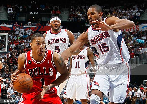 Derrick Rose of the Chicago Bulls drives against Al Horford of the Atlanta Hawks in Game Four of the Eastern Conference Semifinals in the 2011 NBA...