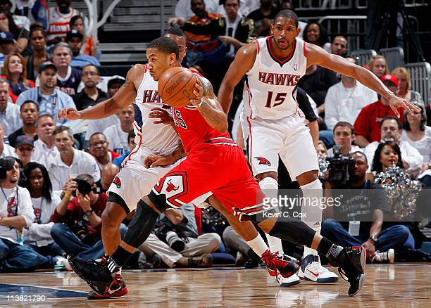Derrick Rose of the Chicago Bulls drives against Jeff Teague of the Atlanta Hawks in Game Three of the Eastern Conference Semifinals in the 2011 NBA...