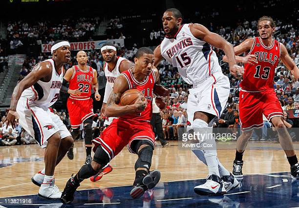 Derrick Rose of the Chicago Bulls drives against Joe Johnson and Al Horford of the Atlanta Hawks in Game Three of the Eastern Conference Semifinals...