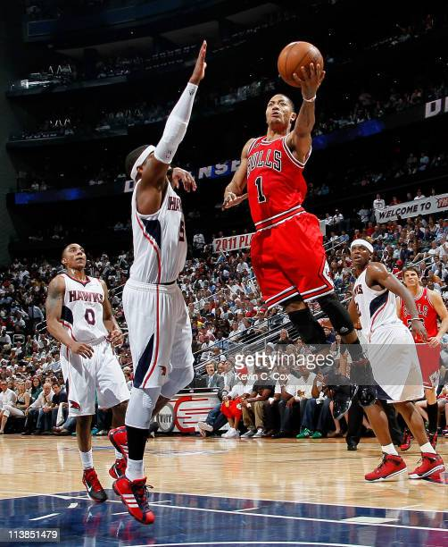 Derrick Rose of the Chicago Bulls drives against Josh Smith of the Atlanta Hawks in Game Four of the Eastern Conference Semifinals in the 2011 NBA...
