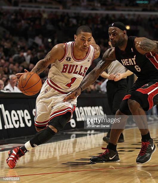 Derrick Rose of the Chicago Bulls drives against LeBron James of the Miami Heat at the United Center on February 24 2011 in Chicago Illinois The...