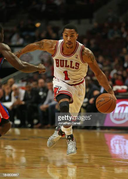 Derrick Rose of the Chicago Bulls drives against the Detroit Pistons during a preseason game at the United Center on October 16 2013 in Chicago...