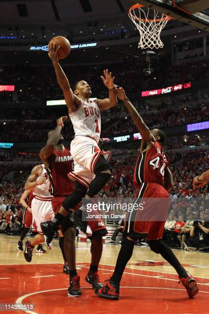 Derrick Rose of the Chicago Bulls drives for a shot attempt against Udonis Haslem of the Miami Heat in Game Two of the Eastern Conference Finals...