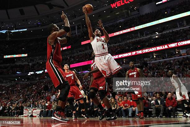 Derrick Rose of the Chicago Bulls drives for a shot attempt against Chris Bosh of the Miami Heat in Game Five of the Eastern Conference Finals during...