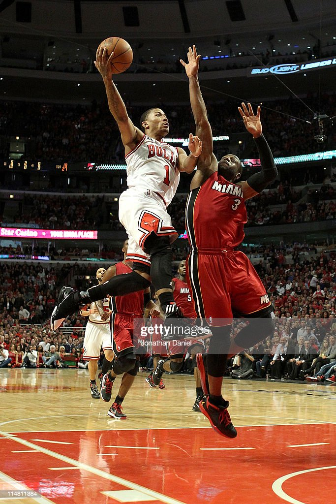Derrick Rose #1 of the Chicago Bulls drives for a shot attempt against Dwyane Wade #3 of the Miami Heat in Game Five of the Eastern Conference Finals during the 2011 NBA Playoffs on May 26, 2011 at the United Center in Chicago, Illinois.