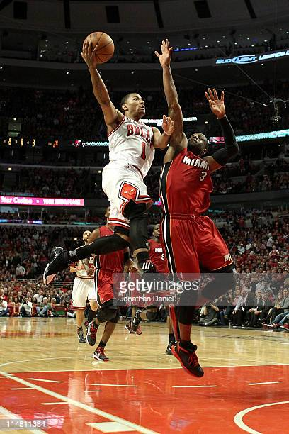 Derrick Rose of the Chicago Bulls drives for a shot attempt against Dwyane Wade of the Miami Heat in Game Five of the Eastern Conference Finals...