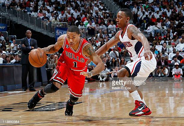 Derrick Rose of the Chicago Bulls drives past Jeff Teague of the Atlanta Hawks in Game Four of the Eastern Conference Semifinals in the 2011 NBA...