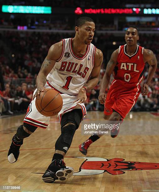 Derrick Rose of the Chicago Bulls drives past Jeff Teague the Atlanta Hawks in Game Two of the Eastern Conference Semifinals in the 2011 NBA Playoffs...