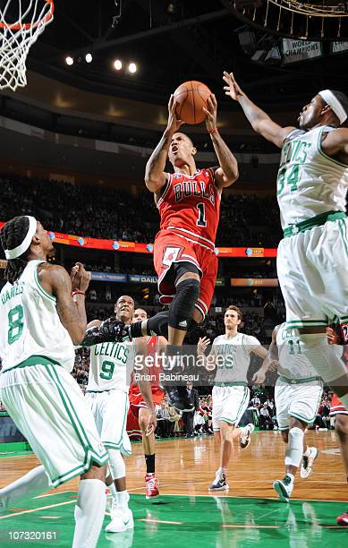 Derrick Rose of the Chicago Bulls drives the lane against Paul Pierce of the Boston Celtics on December 3 2010 at the TD Garden in Boston...