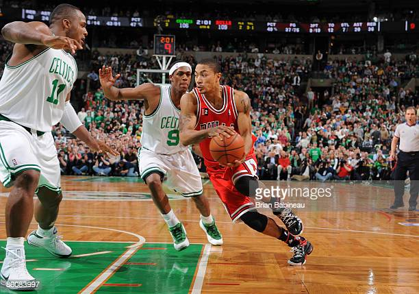 Derrick Rose of the Chicago Bulls drives the lane against Rajon Rondo of the Boston Celtics in Game Two of the Eastern Conference Quarterfinals...