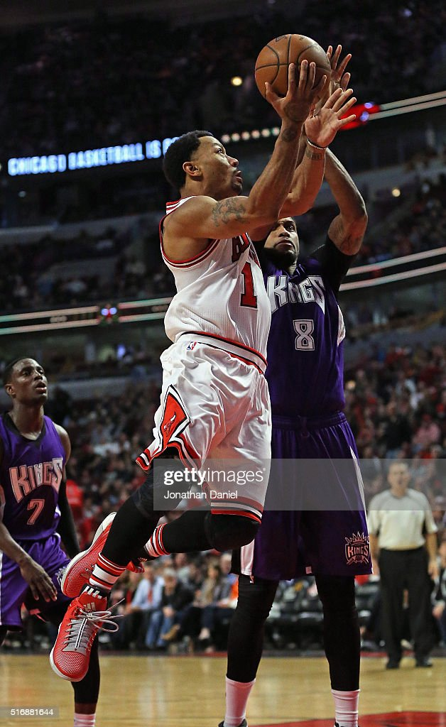 Derrick Rose #1 of the Chicago Bulls drives to the basket against Rudy Gay #8 of the Sacramento Kings at the United Center on March 21, 2016 in Chicago, Illinois. The Bulls defeated the Kings 109-102.