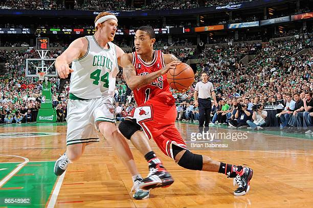 Derrick Rose of the Chicago Bulls drives to the basket past Brian Scalabrine of the Boston Celtics in Game Seven of the Eastern Conference...