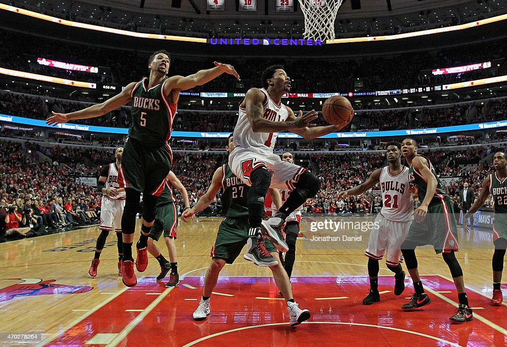 Derrick Rose #1 of the Chicago Bulls drives to the basket past Michael Carter-Williams #5 of the Milwaukee Bucks during the first round of the 2015 NBA Playoffs at the United Center on April 18, 2015 in Chicago, Illinois. The Bulls defeated the Bucks 103-91.