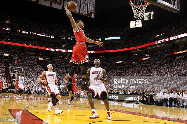 Derrick Rose of the Chicago Bulls dunks against LeBron James and Mike Bibby of the Miami Heat in Game Four of the Eastern Conference Finals during...