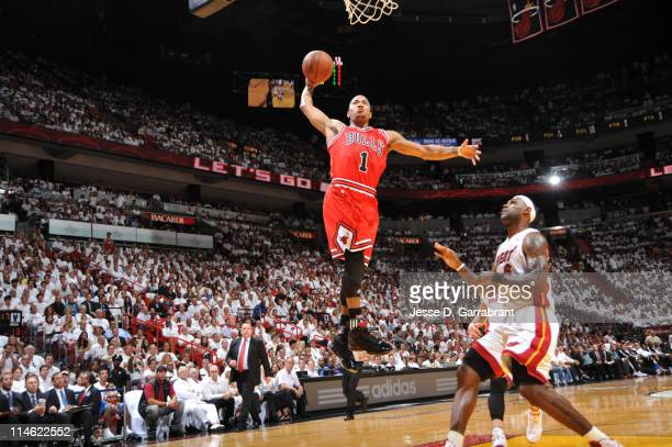 Derrick Rose of the Chicago Bulls dunks against LeBron James of the Miami Heat during Game Four of the Eastern Conference Finals in the 2011 NBA...