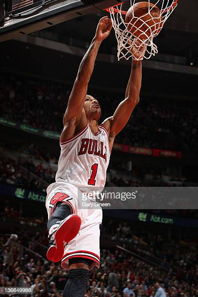 Derrick Rose of the Chicago Bulls dunks against the Detroit Pistons during the NBA game on January 9 2012 at the United Center in Chicago Illinois...