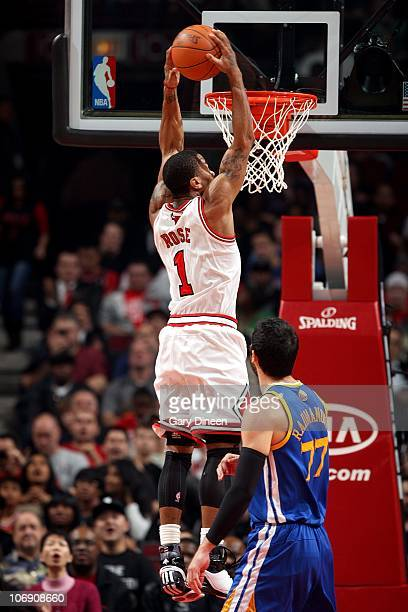 Derrick Rose of the Chicago Bulls dunks against the Golden State Warriors during the NBA game on November 11 2010 at the United Center in Chicago...