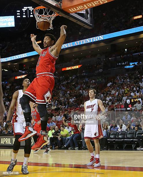 Derrick Rose of the Chicago Bulls dunks during a game against the Miami Heat at American Airlines Arena on April 9 2015 in Miami Florida NOTE TO USER...