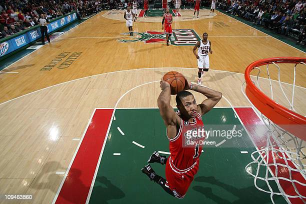 Derrick Rose of the Chicago Bulls dunks on a fast break against the Milwaukee Bucks during the NBA game on February 26 2011 at the Bradley Center in...