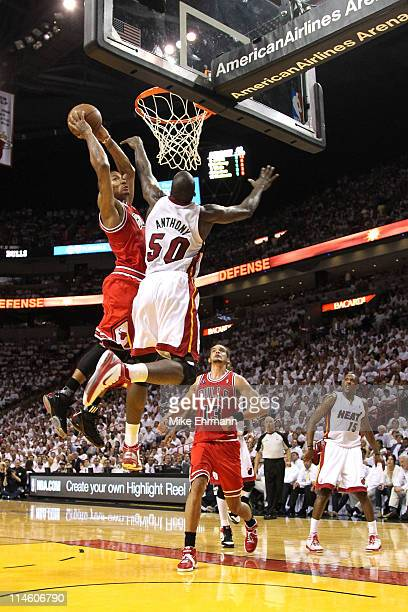 Derrick Rose of the Chicago Bulls dunks on Joel Anthony of the Miami Heat in the first half of Game Four of the Eastern Conference Finals during the...