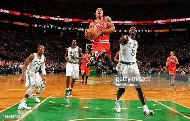 Derrick Rose of the Chicago Bulls dunks the ball against the Boston Celtics on January 13 2012 at the TD Garden in Boston Massachusetts NOTE TO USER...