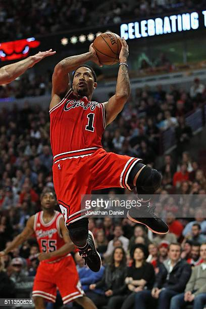 Derrick Rose of the Chicago Bulls gets off a shot against the Toronto Raptors at the United Center on February 19 2016 in Chicago Illinois The Bulls...