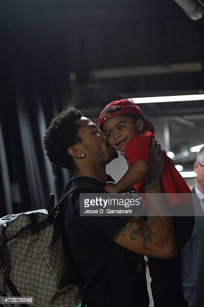 Derrick Rose of the Chicago Bulls gives his son PJ a kiss after hitting the game winning shot against the Cleveland Cavaliers at the United Center...