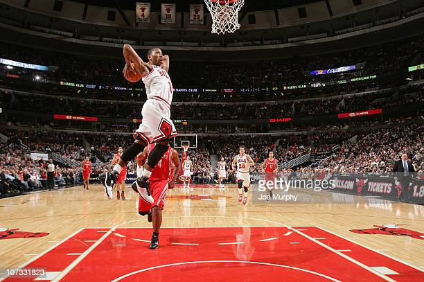 Derrick Rose of the Chicago Bulls goes for a dunk during the NBA game against the Houston Rockets on December 4 2010 at the United Center in Chicago...