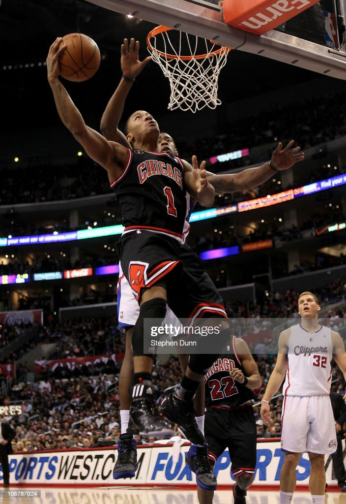 Derrick Rose #1 of the Chicago Bulls goes up for a basket over DeAndre Jordan #19 of the Los Angeles Clippers at Staples Center on February 2, 2011 in Los Angeles, California.