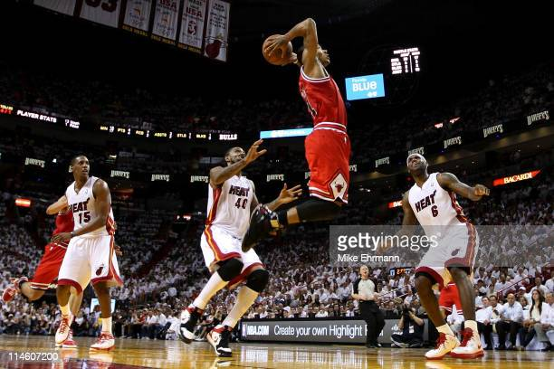 Derrick Rose Of The Chicago Bulls Goes Up For A Dunk Against Mario Chalmers Udonis Haslem