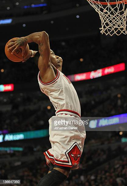 Derrick Rose of the Chicago Bulls goes up for a dunk against the Detroit Pistons at the United Center on January 9 2012 in Chicago Illinois The Bulls...