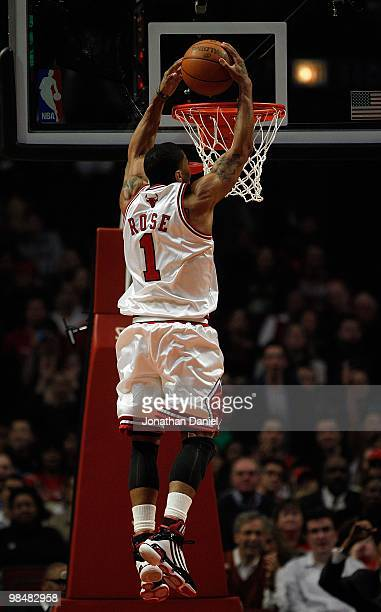 Derrick Rose of the Chicago Bulls goes up for a dunk against the Utah Jazz at the United Center on March 9 2010 in Chicago Illinois The Jazz defeated...