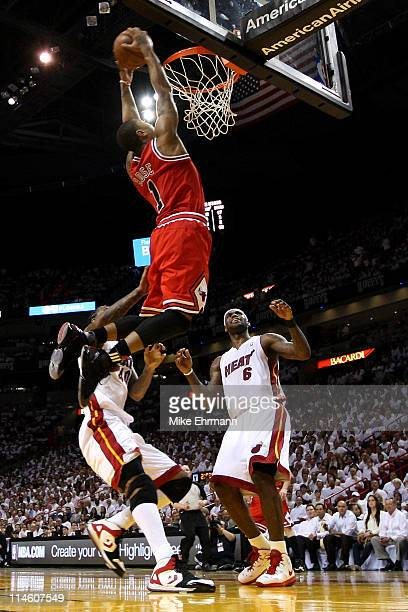 Derrick Rose of the Chicago Bulls goes up for a dunk against Udonis Haslem and LeBron James of the Miami Heat in the first half of Game Four of the...
